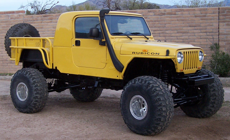 Jeep*. Rear Window Opens For A Nice Breeze. Top And Doors Are Removable.  Pull Two Pins At The Front Of The Bed And It Will Tilt Up, Like A Dump Truck .